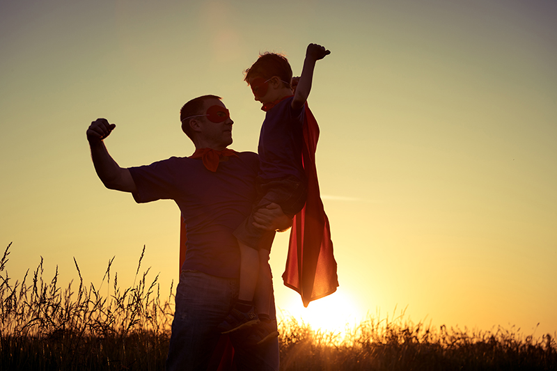 father-and-son-playing-superhero-at-the-sunset