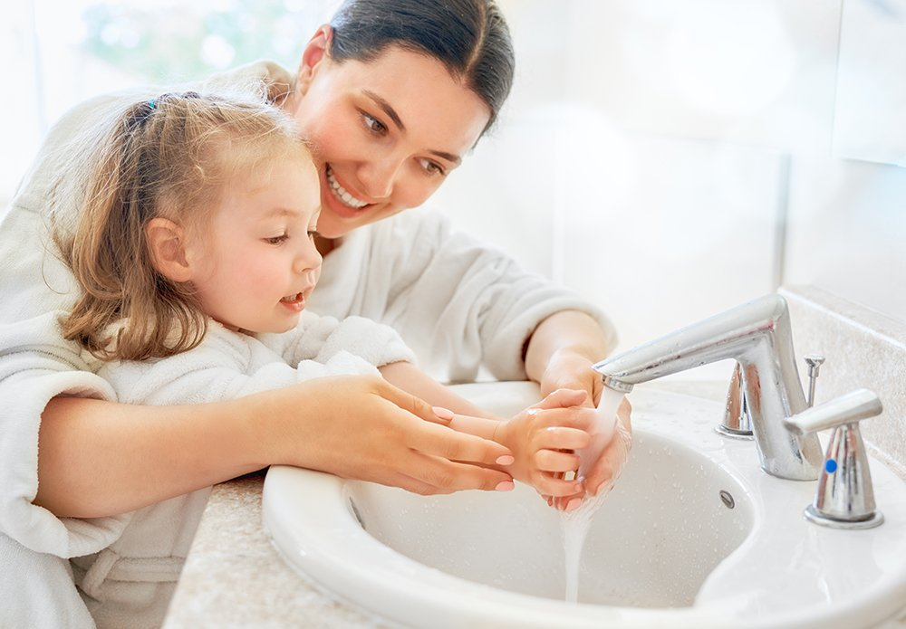 girl-and-her-mother-are-washing-hands-Z6GCLU7