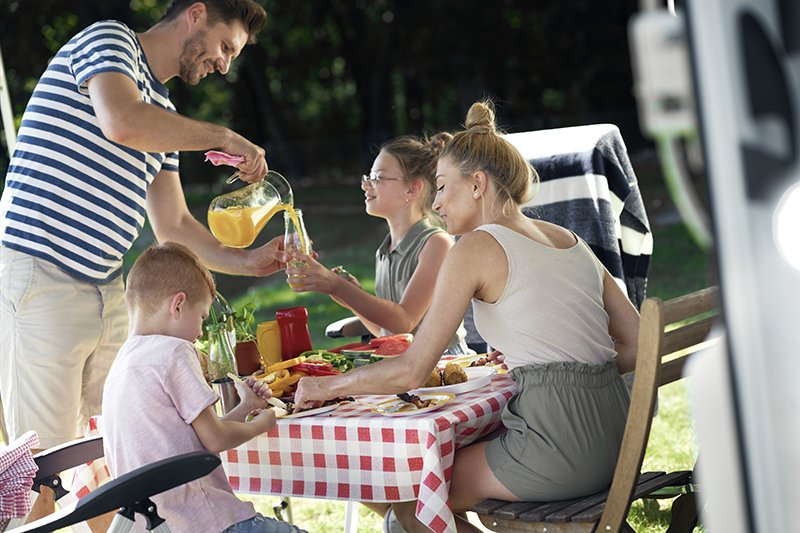 cheerful-family-on-the-camping-C9YYG8W