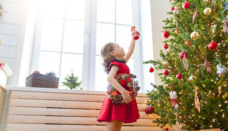 girl-is-decorating-christmas-tree