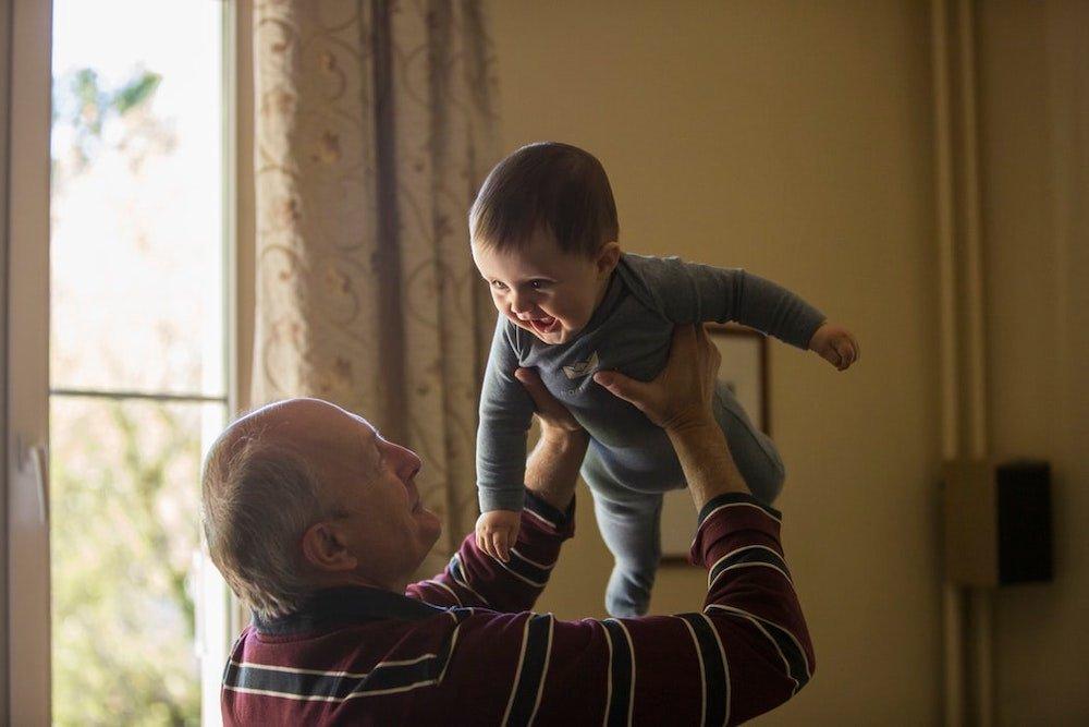 grandpa-holding-child